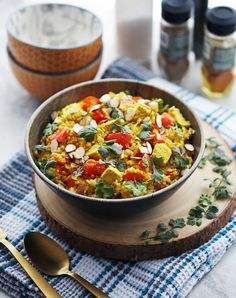 A flavorful and healthy vegan meal featuring turmeric, cumin, and coriander spiced quinoa, cauliflower rice, and tofu! Making Cauliflower Rice, Coriander Spice, Sliced Almonds, How To Cook Quinoa, Rice Bowls, Turmeric, Tofu, Instant Pot, A Food