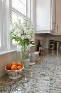 White cabinets, giallo ornamental granite, white/cream/light grey subway tile