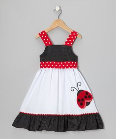 This dress was made for romping about in the sunshine. The generous room lets little bodies run and tumble and wiggle all over the park. A sweet appliqué ladybug is undeniably adorable, and the washable construction makes for practical dressing.