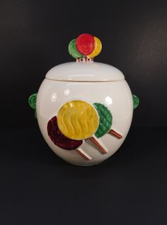 Vintage McCoy Lollipop Cookie Jar  Measures 9 1/4 inches in height, and 7 inches in diameter at the