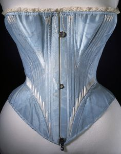 Corset    Place of origin:  France (possibly, made)   Great Britain, United Kingdom (possibly, made)    Date:  1864 (made)    Artist/Maker:  Unknown (production)    Materials and Techniques:  Silk, edged with machine-made lace, reinforced with whalebone, metal, lined with cotton twill    Credit Line:  Given by the Burrows family