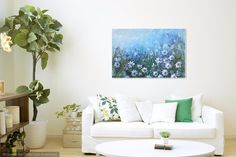 Daisies in Profusion, acrylic painting on canvas. Spring inspired painting. Beautiful white daisies and even ladybugs in a wild field of flowers on a clear blue sky day.