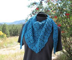 A quick lacy shawlette that can be worn around the shoulders or snuggled up around the neck as as a cozy warm layer with a coat.