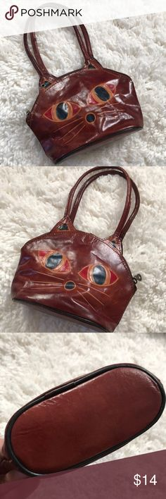 """Leather Mini Kitty Purse Too adorable! All leather, Pre-loved and in good shape. Clean inside too! (A great bundle item).   Width: 8"""" Height of Bag portion: 5-1/2"""", With handle: 11"""". Depth: 3"""".  Shop smart by maximizing your shipping $. Use the filter function and peruse my closet of over 1,000 items! Bundle and save!! Bags Mini Bags"""