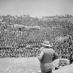 Prime Minister Winston Churchill addresses British troops in the old Roman amphitheater at Carthage Tunisia on 1 June 1943.