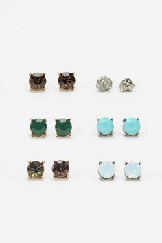 I try to wear fun earrings, but I always go back to studs.  These are pretty and I really need those green ones!