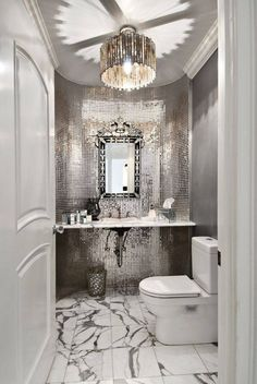 Add a little sparkle to your bathroom with mirrored tile!   This style might be overly glamorous for many homeowners. What do you think?
