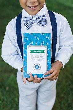 blue woodsy wedding program with tree pattern