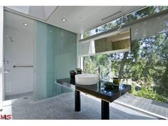 Pinned from Thank You For Being Sophisticated: The best in modern and mid-century design, decor and exteriors.  #Interior #Design #Architecture #Midcentury #modern #bath #bathroom #shower #sink #vanity #finishes #hollywoodregency #hollywood #regency