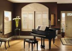 Product: Wood Shutters Color: 1683 Options Shown:Elongated Arch over Standard Panels (left) and Café Panels (right). Standard and Café Panels with 2 Louvers, L-Frame, Astragal and Hide-a-Tilt®. Elongated Arch with L-Frame. All in Dover White Arched Window Treatments, Arched Windows, Blinds For Windows, Window Coverings, Window Blinds, Interior Shutters, Wood Shutters, Discount Blinds, Cheap Windows