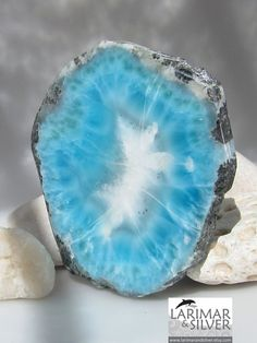 Larimar - a rare form of blue pectolite created by volcanic activity that balances water and fire energy.