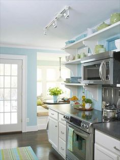 Love these colours- pale blue and lime green. The grey counters and white cabinets look pretty with this pallet, although I would go with light oak or pine for the woods, myself. --Meggie