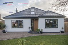 This 60's bungalow has gone through the ultimate renovation, complete with windows, sliding doors and a roof lantern. #glazing #aluminium #windows #slidingdoors #renovation #homeinspo #bungalow #bungalowrenovation