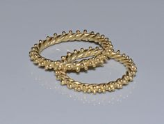 Antioch Gold Granulated Twisted Stacking Rings by Kosmimata, $400.00