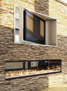 Indoor outdoor fireplace is dispensable for any contemporary house. You can create magical ambience, make your place more attractive, inviting in both living spaces: interior and exterior. Outdoor Gas Fireplace, Indoor Outdoor Fireplaces, Fireplace Tv Wall, Outdoor Fireplace Designs, Fireplace Inserts, Fireplace Ideas, Wall Fireplaces, Fireplace Windows, Bedroom Fireplace