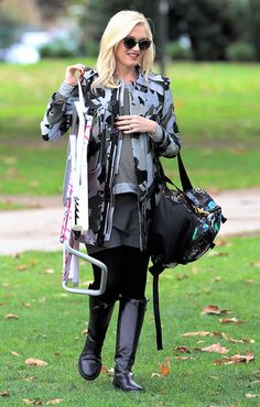 All smiles on the sideline, the expecting mama kept warm at her son Kingston's soccer game by layering a camo jacket over her Seraphine skirt.