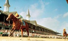 Unbridled, with jockey Craig Perret, wins the 1990 Kentucky Derby, over rival Summer Squall and Pat Day.  Unbridled is the great-grandsire of 2015 Triple Crown champ American Pharoah. Credit: AP Photo/Bob Daugherty