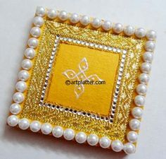 kundan rangoli in gold and silver on wooden base