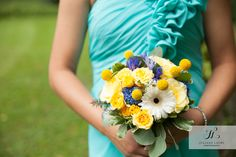 Yellow flowers with teal bridesmaid dress
