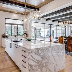 So many amazing details in this kitchen, featuring a massive waterfall island and our Travis pendants + Gideon chandelier🖤 Design:… Quartz Countertops, Kitchen Countertops, Island Kitchen, Granite, Online Home Decor Stores, Online Shopping, Beautiful Kitchens, New Kitchen, Kitchen Ideas