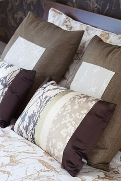 Chocolate and taupe cushions.