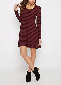 Cozy and casual, this cute swing dress is sure to become a favorite! It's made of a super soft and cozy brushed knit, and features long sleeves, a swing cut and playful stripes. Tent Dress, Swing Dress, Striped Knit, Striped Dress, Black Stripes, Burgundy, Cold Shoulder Dress, Dresses For Work, Rompers