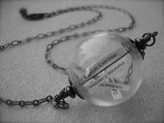 THE REAPING - Hunger Games Inspired GLASS Orb Reaping Ball Necklace District 12 Tributes Katniss Peeta Primrose Gale Personalized. $26.00, via Etsy.