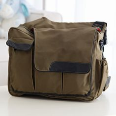 This has my name written on it. Taking Diaper bags to a whole new level of dad coolness....   Diaper Dude Eco Friendly Green Dude Khaki Diaper Bag - $92.99 @hayneedle