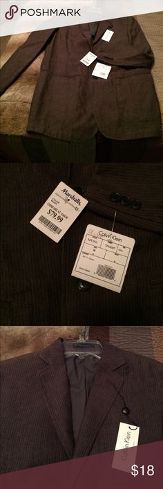 NWT Calvin Klein men's blazer size 38 This is a new with tags Calvin Klein men's pinstripe blazer in a size 38 it's in a gray-ish brownish pinstripe style please see photos.  Great for work they also great to wear out Jess down with jeans casual. Calvin Klein Suits & Blazers Sport Coats & Blazers