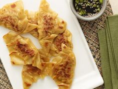 Perfect Potstickers:  1/2 lb ground pork  1/4 cup finely chopped scallions  2 TBLS finely chopped red pepper  1 egg, lightly beaten  2 tsp ketchup  1 tsp yellow mustard  2 tsp Worcestershire   1 tsp light brown sugar  1 1/2 tsp kosher salt  1/2 tsp black pepper  1/4 tsp cayenne pepper  35 to 40 small wonton wrappers  3 to 4 TBLS vegetable oil, for frying  1 1/3 cups chicken stock, divided