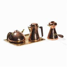 Austria, circa 1950 consisting of 2 coffee pots and 1 teapot Karl Hagenauer (1898-1956) -Hagenauer Werkstätte Wien (1898-1987) - Manufactory for arts and design objects<br>Each piece stamped 'KARL / WERKSTÄTTEN HAGENAUER WIEN / MADE IN AUSTRIA' and marked with the company's logo on the underside<br>Height of coffee pots: 18...