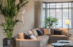 warm interieur voor stadswoning: moderne Woonkamer door choc studio interieur