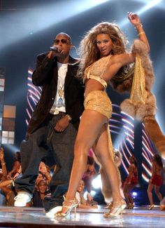 Pin for Later: As Queen Bey Turns 34, Let's Look at Her Sexiest Moments  Beyoncé and her then-boyfriend Jay Z teamed up in August 2003 for the MTV VMAs.