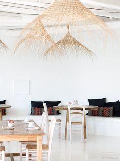 San Giorgio, Mykonos, white walls, tables, chairs / Garance Doré