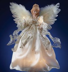 Our magnificent lighted angel tree topper adds the crowning touch to your Christmas tree. Our angel is further embellished with feathery wings. IVORY AND GOLD ANGEL TREE TOPPER. Lighted Angel Tree Topper, Angel Christmas Tree Topper, Buy Christmas Tree, Merry Christmas, Miniature Christmas, Angel Ornaments, Christmas Angels, Xmas Tree, Christmas Ornaments