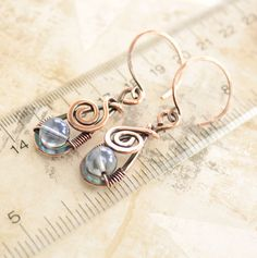 Artisan copper earrings with swirly drop and wrapped by IngoDesign