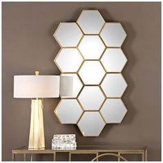 Geometric Wall Mirror a bold geometric frame shape with soft gold lining detail. | wall