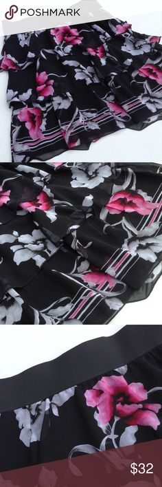 NWT White House Black Market Tiered Floral Skirt Flirty black skirt with feminine pink and gray floral pattern.  Great with tights and boots or sandals.  Perfect office wear or for going out!  Material content in last photo. White House Black Market Skirts Midi