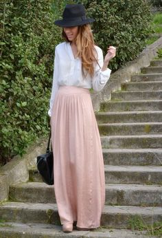 Flowy top, blush maxi skirt and hat for a mysterious vibe.