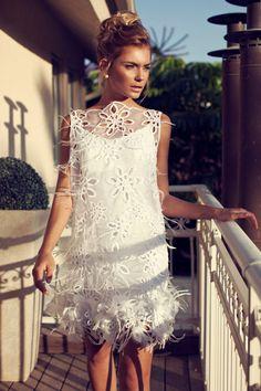 Adorable white mini dress. Perfect for pre wedding celebrations