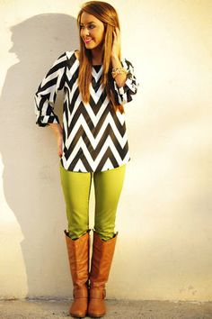 chevron blouse with mint jeans and brown boots. Gold bracelets or watch.