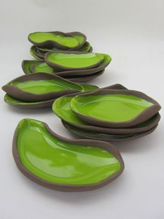 "Appetizer dishes. ""Chocolate-Pistachio"" series (brown clay, apple green glaze). Hand built earthenware ceramics by Pottery Studio Saskia Lauth / France. www.saskia-lauth.com"