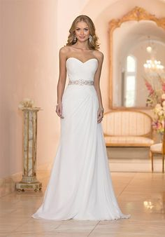 This sleek Stella York sheath bridal gown was imagined and handcrafted to provide an exceptional fit. It's made from breezy Tulle and corded Lace, and features a slimming Diamante beaded Tulle waist belt. The back zips up under fabric-covered buttons. Inspired by the world's hottest red carpet trends, this Stella York bridal gown is handcrafted with stunning details that stand the test of time.