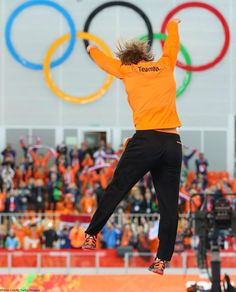 This is a high jump of joy and celebrating winning a medal.  The Dutch have dominated speed skating. They own it in Sochi 2014.