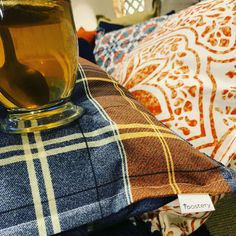 Cuddled up with all the pillows and blankets 🖤🖤🖤. I ordered these custom pillows from in fabric designed by I was so happy to find fabrics that complemented my navy and burnt orange fall decor.