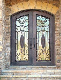 wrought iron front doors incorporate into breezeway area