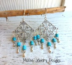 Turquoise stone and sterling silver chandelier earrings.