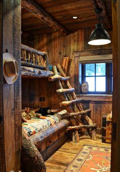I wouldn't mind sleeping there!!  log cabin bunk room