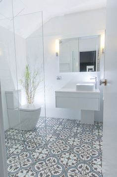 tile flooring for bathrooms this beautiful white bathroom design has combined a modern white vanity unit and toilet with a more traditionally inspired pattern tiled floor marble tile bathroom floor id Patterned Bathroom Tiles, Shower Room, Small Bathroom, Modern Bathroom, Bathroom Renovations, Bathroom Flooring, Bathroom Shower, Bathroom Decor, Bathroom Inspiration