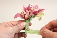 Tape the orchid blooms to each other one at a time.